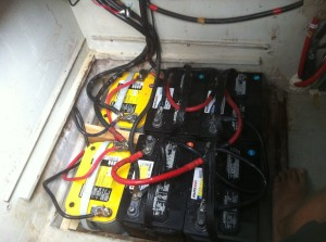 The yellow Optima batteries are still going strong on the engine side, but we had to replace all of the old black house batteries. The extended battery takes up about twice as much space as what is pictured here.