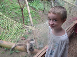 Duncan poses with a playful monkey that put on a real show for the kids.
